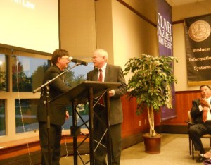 Dr. Fred Beuttler accepts the Center's 2015 Christian Citizenship Award from Dr. Charlie Emmerich on behalf of his parents, Fred and Doris Beuttler.