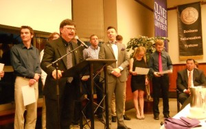 Dr. Charlie Emmerich, Center Executive Director, and Mr. Zach Bohannon, Center Director, present the 2015 LJC Institute graduates with their certificates.