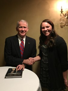 Col. North with Olivet Legal Studies student, MacKenzie Mehaffey.